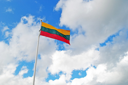 clody: Lithuanian flag on clody sky Stock Photo