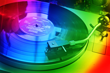 lps: Vintage dj turntable for vinyl LPs in rainbow colors Stock Photo