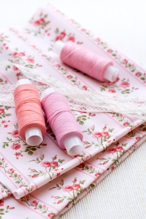 Spools of thread, lace and fabric photo