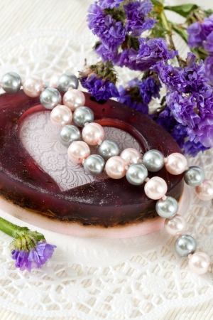 Handmade soap, pearl beads and flowers limonium photo