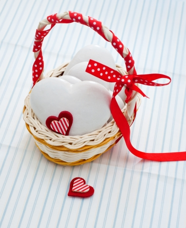 Gingerbread heart-shaped in a wicker basket photo