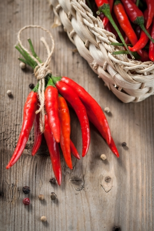 Pods of red pepper in a wicker basket photo