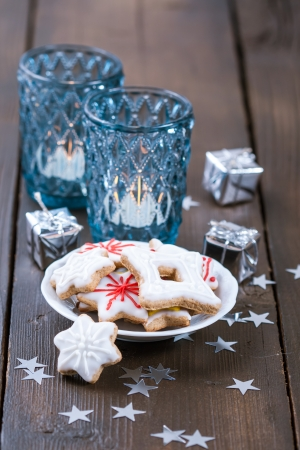 Blue Christmas candles and Christmas homemade cookies photo