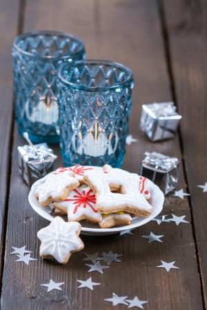 Blue Christmas candles and Christmas homemade cookies