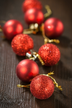Small red Christmas balls on a wooden table photo