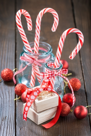 Christmas candy canes in glass jar photo