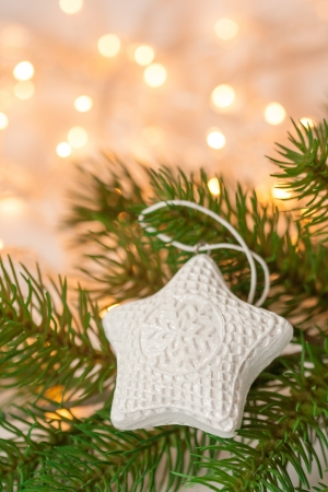 White star shaped Christmas decoration on the tree photo