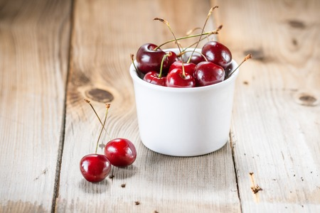 Fresh cherries in a bowl on the table photo