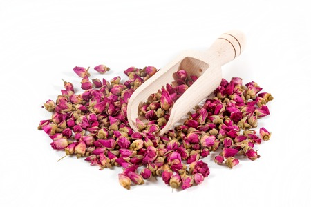 Dried rose buds on the white background