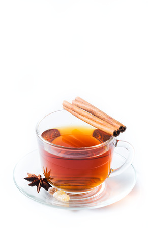 Cup of tea with condiments on white background