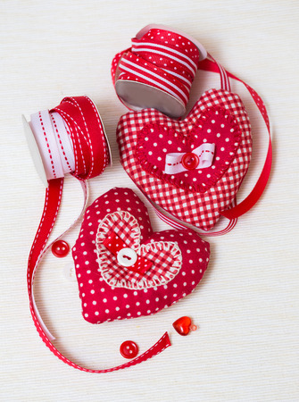 Valentine handmade hearts with ribbons and buttons photo