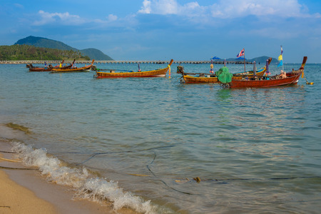 Traditional Thai boat, Long tail stand in the sea. Thailand photo