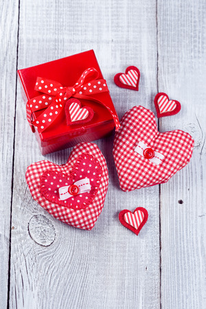 Gift boxes and decorative heart on wooden background photo