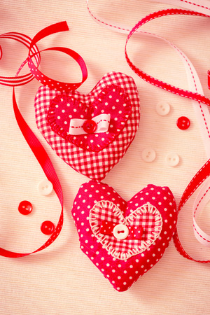 Valentine handmade hearts with ribbons and buttons. Retro color toning. photo