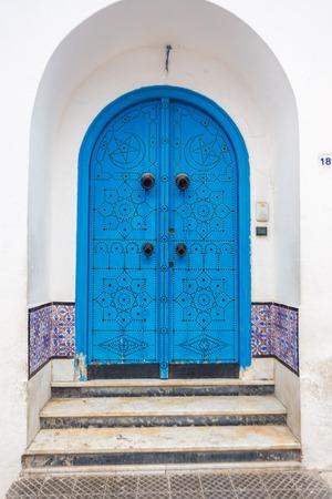 sidi bou said: Sidi Bou Said - typical building with white walls, blue doors and windows, Tunisia Stock Photo