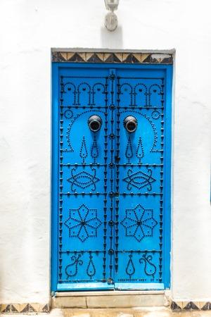 sidi bou said: Sidi Bou Said - Beautiful ornamental blue door of so typical shape for Tunisia Stock Photo