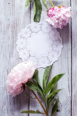 Beautiful Pink peonies flowers on wood background
