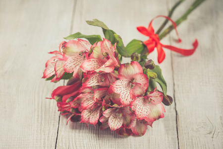 alstromeria: Spring decoration with pink alstromeria flowers of a wooden table Stock Photo