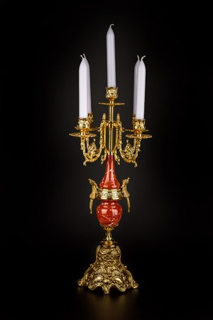 candle holder: Antique bronze chandelier - candle holder on a black background. Bronze and red marble.
