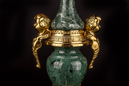 candle holder: Antique bronze chandelier - candle holder on a black background. Bronze and green marble. Detail