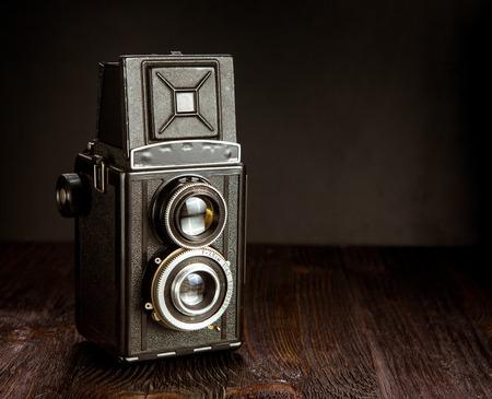 the medium: Old medium format camera on a wooden background