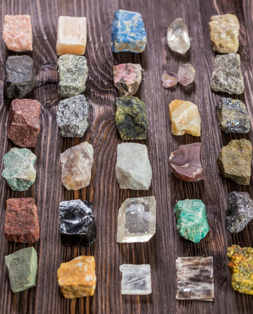 tumbled stones: Collection set of minerals and stones on the old wooden table.