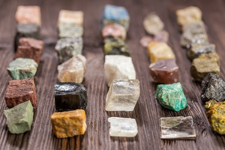 Collection set of minerals and stones on the old wooden table.