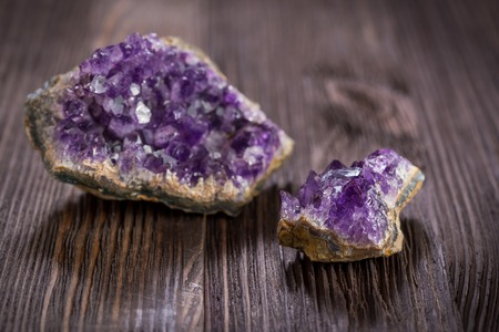 Beautiful Druse amethyst on dark wooden background