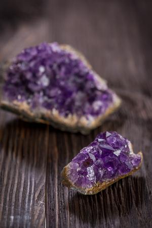 amethyst rough: Beautiful Druse amethyst on dark wooden background