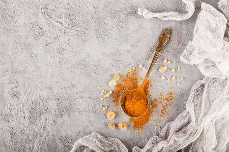 Different kinds of spices - cinnamon, caramelized brown sugar on gray concrete background. Top view with copy space Stock Photo