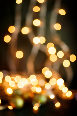 Golden lights bokeh defocus abstract background. Gold Festive Christmas. Glitter twinkled bright background. Stock Photo
