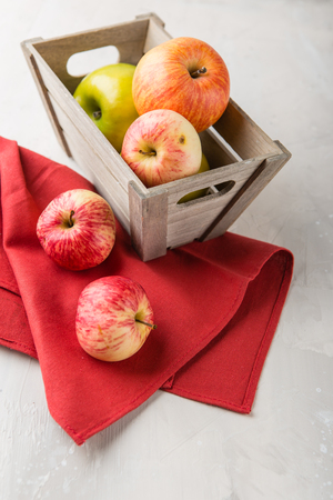 Decorative wooden box with red and green ripe apples