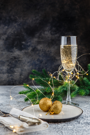 Christmas and New Year celebration with champagne. New Year holiday decorated table. Two Champagne Glasses. Holiday Decorations. Copy space.