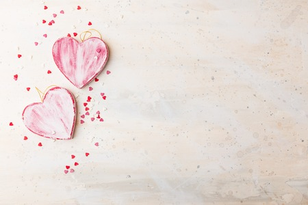 Valentines day background with two red shabby hearts on light background. Top view. Space for text.
