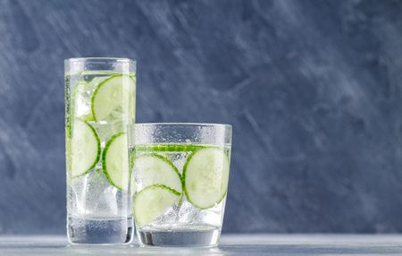 Fresh cool cucumber infused water, cocktail, detox drink, lemonade in a glass. Health care, fitness, healthy nutrition diet concept. Reklamní fotografie