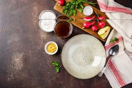 Served empty plate for summer soup Okroshka with radish, parsley, sour cream, mustard, salt and kvass. Space for text. Reklamní fotografie