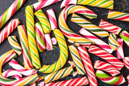 High angle view of a broken candy cane on dark background.