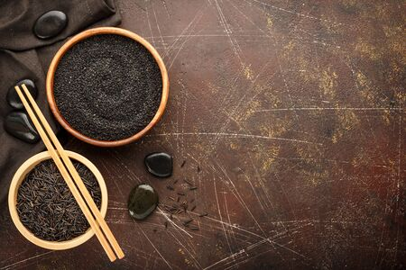 Close up of black sesame seed, Sesamum indicum in wooden bowl