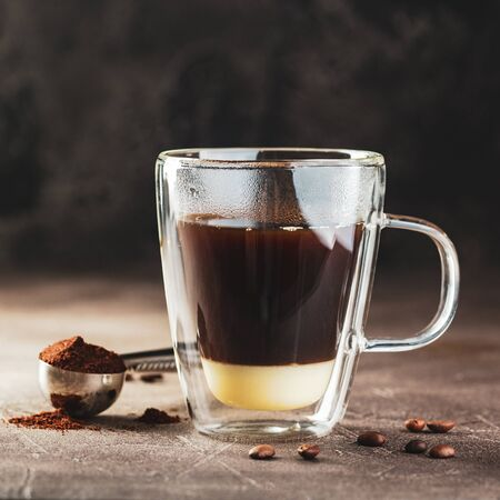 Vietnamese coffee with condensed milk in glass cups. Traditional method of making of vietnamese coffee