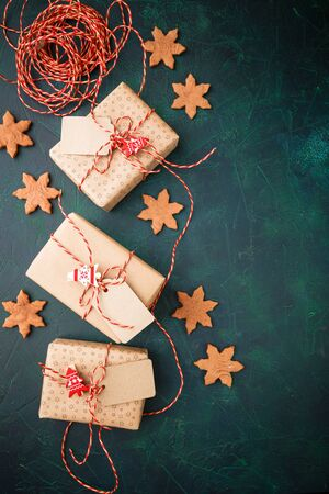 Gingerbread christmas cookies snowflakes with decoration and christmas gift boxes