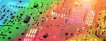Electronic circuit board with electronic components such as chips close up. The concept of the electronic computer hardware technology. Tech science background. Long wide banner, shallow DOF