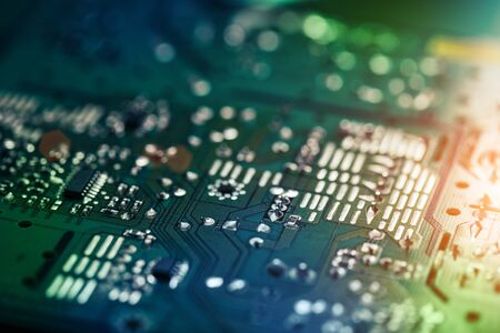 Electronic circuit board with electronic components such as chips close up. The concept of the electronic computer hardware technology. Tech science background. Information engineering component.