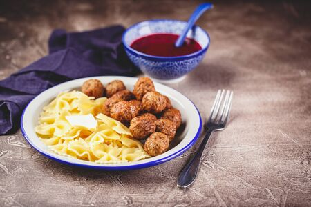 Pasta Farfalle with meatballs and cranberry sauce with spices and herbs rosemary, cinnamon and anise. Stewed meatballs in sweet berry sauce. Place for text. Stock fotó