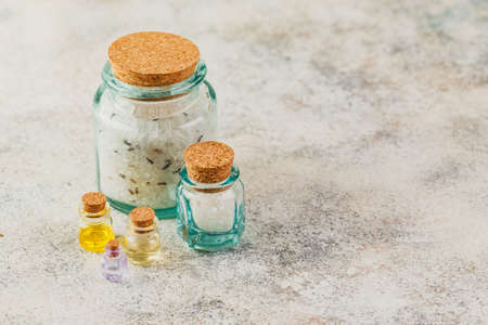 Aromatic oils in glass bottles, aromatic salts and dry lavender. Concept natural ogranic skincare cosmetic. Stock Photo