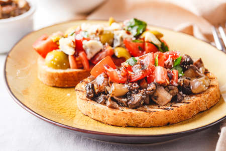 Delicious Bruschetta with tomatoes and mushrooms, and bruschetta with blue cheese, olives and tomatoes Zdjęcie Seryjne