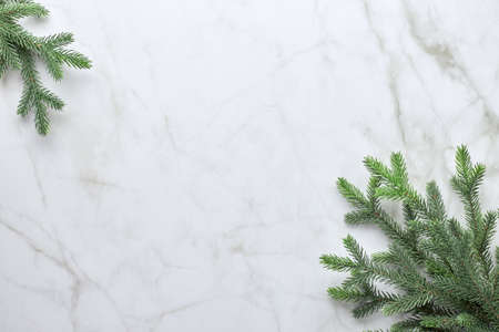 Christmas background with branches of a Christmas tree in the form of a frame. Flat lay, top view with copy space