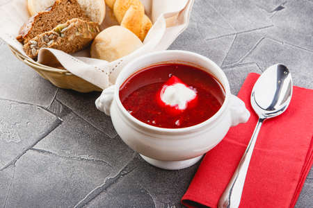 Ukrainian and Russian national red borsch with sour cream and herbs. Bowl of red beetroot soup