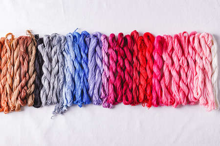 Colorful background from embroidery threads in all colors of the palette