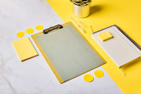 Desktop with clipboard mockup and office supplies. Home office, planning goal setting concept. Stock Photo
