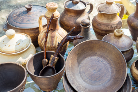 Clay dishes. Traditional rustic crockery. Brown and beige pottery plates, jugs, vases and pots Stock Photo